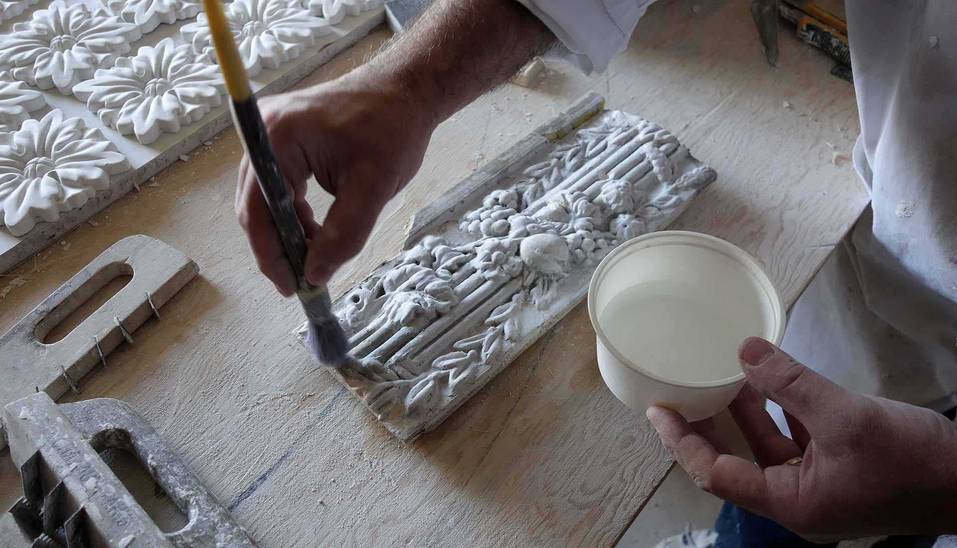 Restoring plasterwork trim at Macdonell-Williamson House