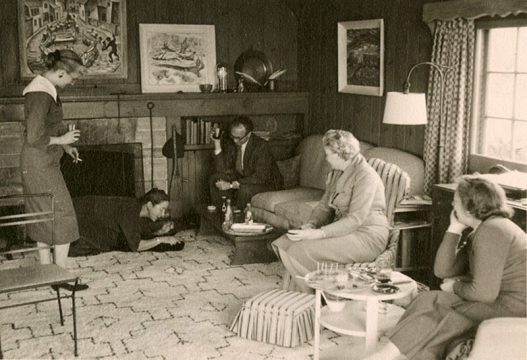 Doris McCarthy entertaining friends in her living room at Fool's Paradise