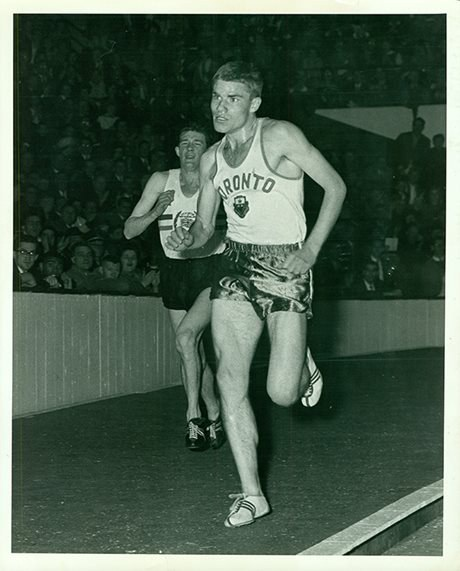 Bruce Kidd running the three-mile race at the Telegram Maple Leaf Games, January 25, 1963 (Photo courtesy of University of Toronto Archives. Credit: Mihkel Turk)