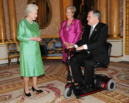David Onley, as Ontario Lieutenant Governor, meeting Her Majesty the Queen at Buckingham Palace