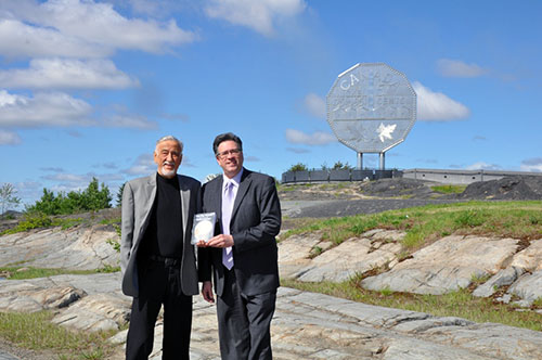 Ted and Jim Szilva standing near the Big Nickel