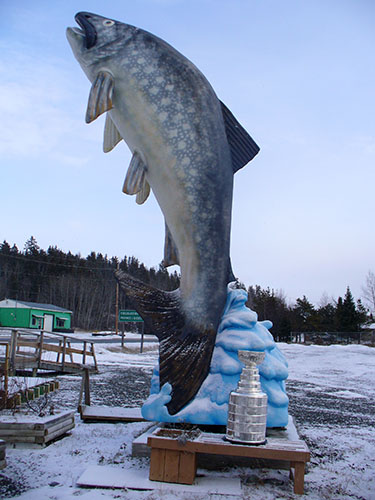 Stanley Cup in front of large fish, Larder Lake, Ontario