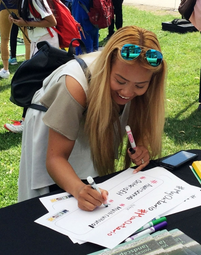 "Filling out a ""MyOntario is"" form at Toronto's Fort York on National Aboriginal Day"