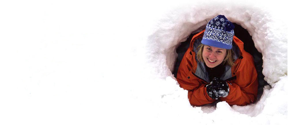 Woman tunnelling in snow